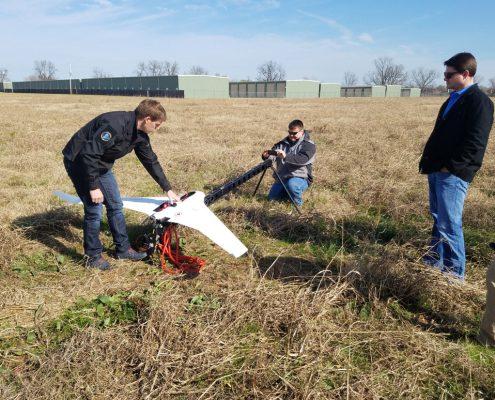 Landpoint team preparing drone for flight